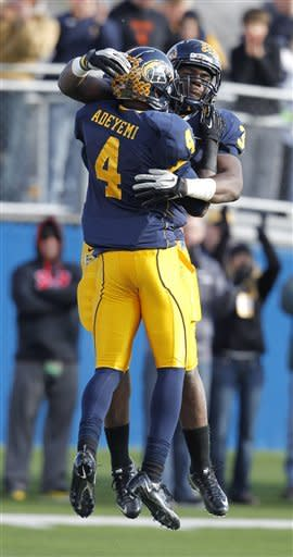Kent State's Eric Adeyemi celebrates with Trayion Durham after Adeyemi caught a touchdown pass against Ohio during the fourth quarter of an NCAA college football game Friday, Nov. 23, 2012, in Kent, Ohio. Kent State won 28-6. (AP Photo/Ron Schwane)