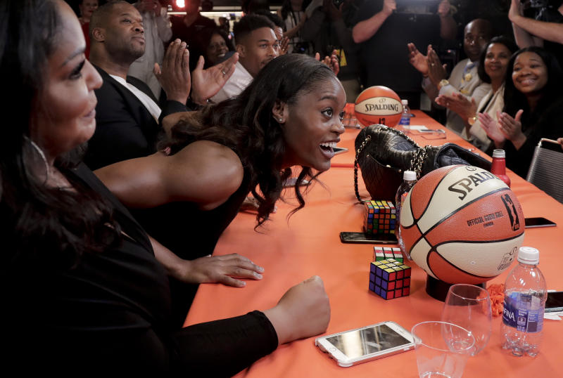 Kaela Davis reacts after being selected as the the 10th overall pick in the WNBA basketball draft by the Dallas Wings, Thursday, April 13, 2017, in New York. (AP Photo/Julie Jacobson)