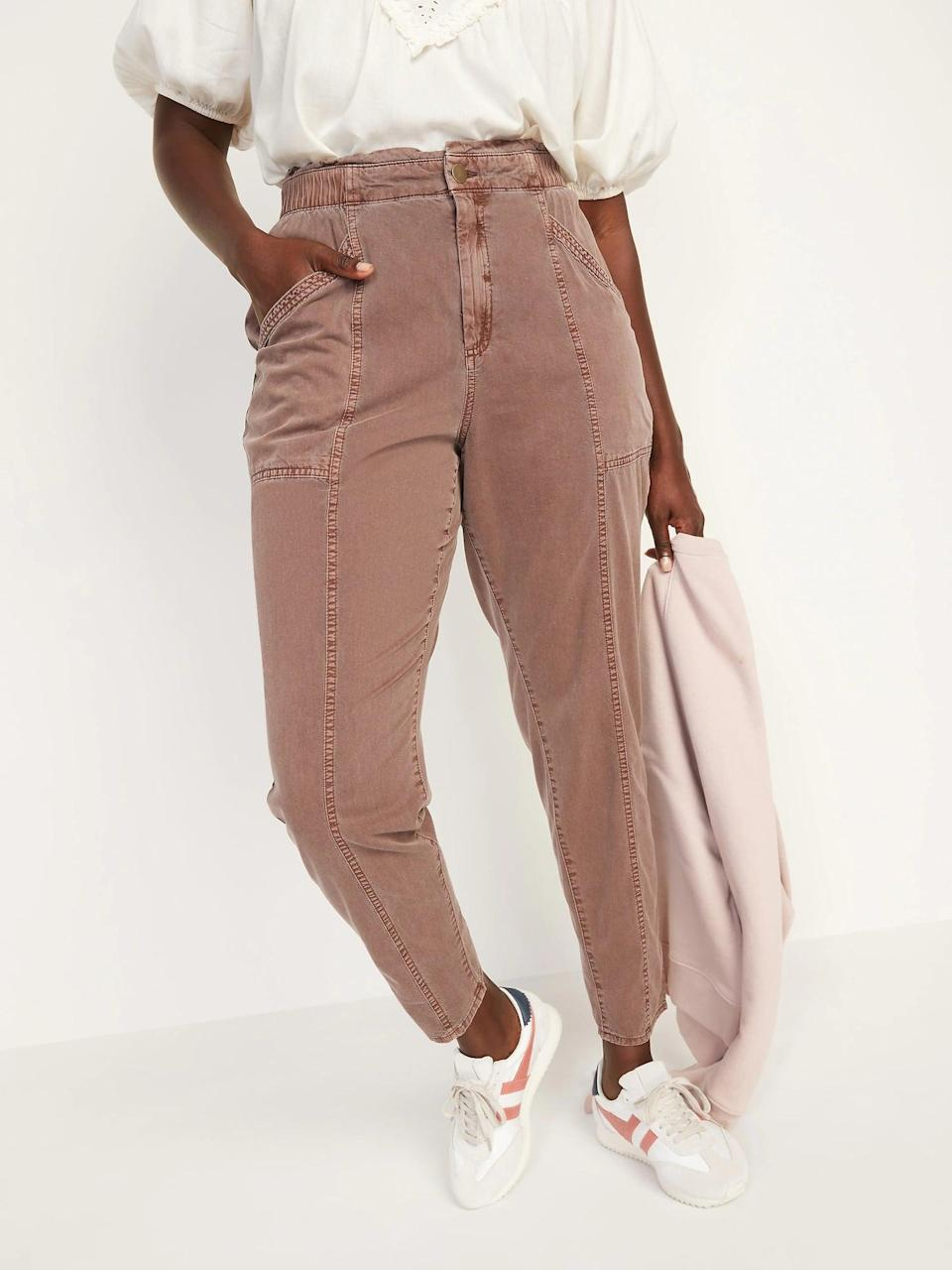 <p>The paperbag waist on these <span>Old Navy High-Waisted Garment-Dyed Utility Pants</span> ($35, originally $40) made us picture tucking in a favorite tee or slipping a bodysuit underneath instead.</p>