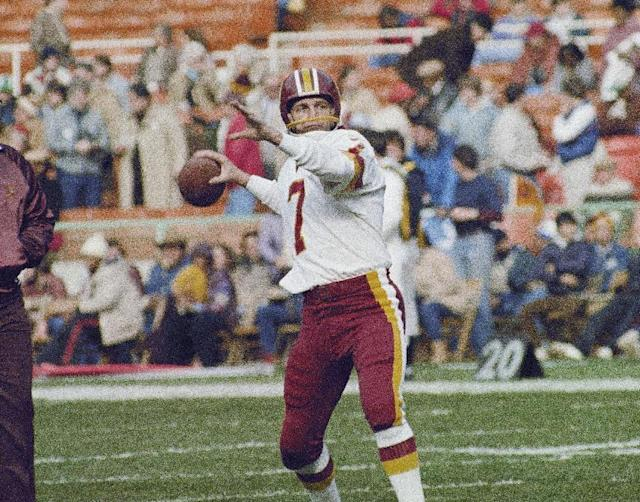 FILE- In this Jan. 8, 1983 file photo, then-Washington Redskins quarterback Joe Theismann (7) passes against the Detroit Lions at RFK Stadium in Washington. (AP Photo/P.Binks, FILE)