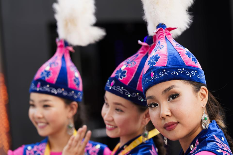 Performers from Kazakhstan's pavilion pose for photographs at Expo 2020, in Dubai, United Arab Emirates, Sunday, Oct. 3, 2021. (AP Photo/Jon Gambrell)