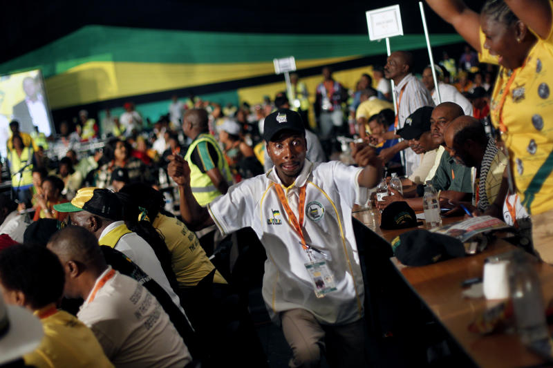 Ruling party African National Congress (ANC) delegates react to the results of a vote that decided overwhelmingly to keep South African President Jacob Zuma as the head of the nation's dominant political force, more than likely guaranteeing the politician another five years in the country's presidency, in Bloemfontein, South Africa, Tuesday, Dec. 18, 2012. Zuma trounced Deputy President Kgalema Motlanthe, his only challenger who ran a largely muted and reluctant campaign, getting 2,983 votes to Motlanthe's 991. (AP Photo/Jerome Delay)