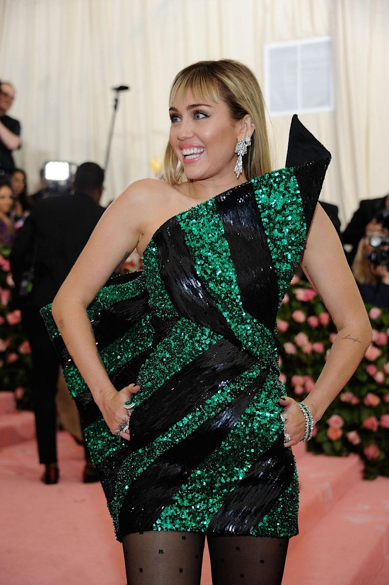 Superstar Miley Cyrus wore BVLGARI archival earrings, bracelet and rings, paired with iconic Serpenti ring and earring to the 2019 Met Gala. (PHOTO: Wireimage)