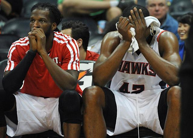 Atlanta Hawks' Elton Brand (42) and DeMarre Carroll sit on the bench as time runs out in the second half of their NBA basketball game against the Portland Trail Blazers Thursday, March 27, 2014, in Atlanta. Portland won 100-85. (AP Photo/David Tulis)