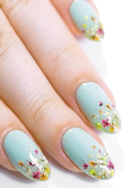 "<p>Instead of painting on flowers, why not apply actual petals? In this Ipsy manicure, Nail artist Kristin Gardner<span> attached <a rel=""nofollow"" href=""https://www.amazon.com/Nail-Art-Real-Dried-Flower/dp/B008EJJ50A/ref=sr_1_16_a_it?tag=syndication-20"">tiny dried blooms</a> to a glitter-ombre base.</span></p><p><span><em><a rel=""nofollow"" href=""https://www.youtube.com/watch?v=goOdS2MoajE"">See more on YouTube »</a> </em><br></span></p>"