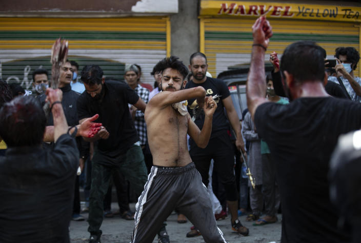 Kashmiri Shiite Muslims flagellate themselves during a Muharram procession in Srinagar, Indian controlled Kashmir, Saturday, Aug. 29, 2020. Muharram is a month of mourning in remembrance of the martyrdom of Imam Hussein, the grandson of Prophet Mohammed. Authorities had imposed restrictions in parts of Srinagar, the region's main city, to prevent gatherings marking Muharram from developing into anti-India protests. (AP Photo/Mukhtar Khan)