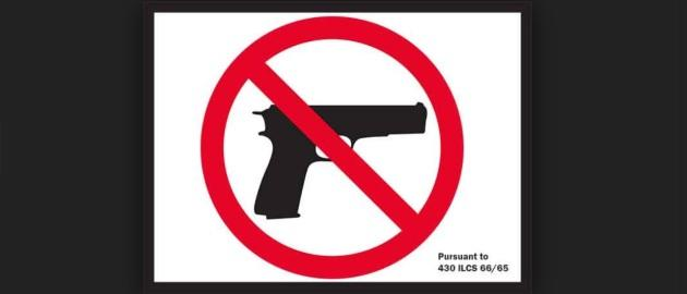 School officials deeply troubled over guns appearing ON SIGNS BANNING GUNS