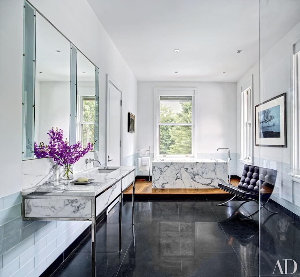 """The master bath of a <a href=""""http://www.architecturaldigest.com/story/historic-new-jersey-estate-renovated-annabelle-selldorf?mbid=synd_yahoo_rss"""">New Jersey estate</a> renovated by architect Annabelle Selldorf and designer Matthew Frederick contains a Mies van der Rohe chair by Knoll and a tub filler by Boffi."""