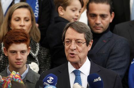 Presidential candidate Nicos Anastasiades talks to the media after casting his ballot, during the second round of the presidential election in Limassol, Cyprus February 4, 2018. REUTERS/Yiannis Kourtoglou