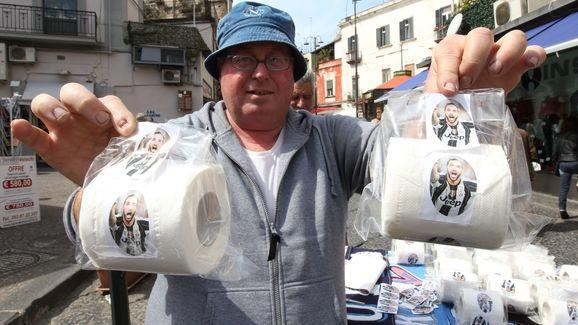 While the Serie A resumes this weekend with a blockbuster match between Napoli and Juventus, Napoli fans have welcomed back Gonzalo Higuain by selling toilet paper pictured with his face. When the 29-year-old Argentine striker transferred from Napoli to Juventus for £75m before the start of the season, El Pipita left the Partenopei fans in disarray and anger. The ultras of the southern Italian club ripped and burnt jerseys with his name printed on them when the league's top goalscorer left for...
