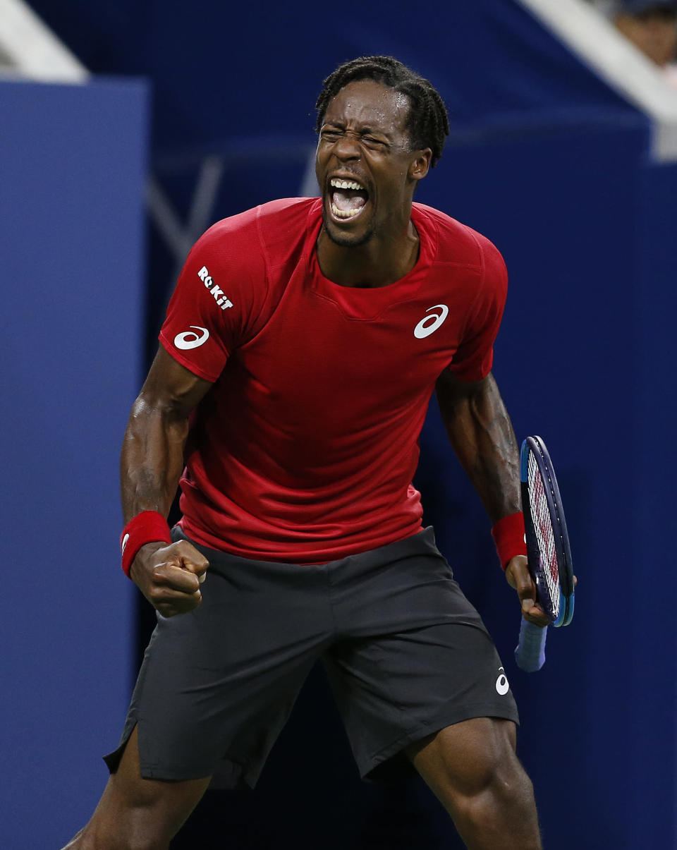 Gael Monfils, of France, reacts after winning a point against Denis Shapovalov, of Canada, during the third round of the U.S. Open tennis tournament, Saturday, Aug. 31, 2019, in New York. (AP Photo/Jason DeCrow)