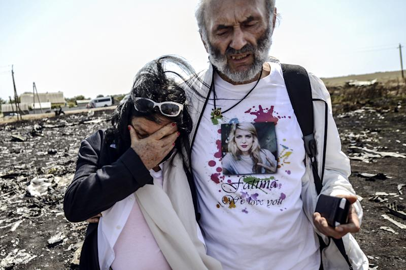 Jerzy Dyczynsk and Angela Rudhart-Dyczynski from Australia react as they arrive at the crash site of the Malaysia Airlines Flight MH17 to look for their late daughter Fatima, near the village of Grabovo, in the Donetsk region on July 26, 2014 (AFP Photo/Bulent Kilic)