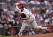 Philadelphia Phillies pitcher Aaron Nola works against the Atlanta Braves during the first inning of a baseball game Sunday, May 9, 2021, in Atlanta. (AP Photo/Ben Margot)