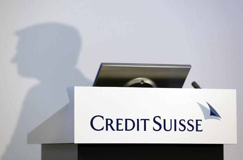 The shadow of Brady W. Dougan, CEO of Credit Suisse, is pictured before the full year results conference in Zurich