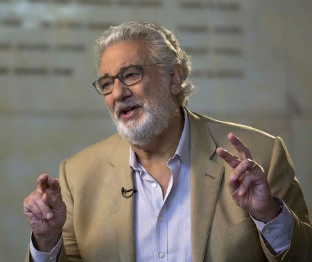 Spanish opera singer Placido Domingo gestures during an interview with Reuters at the Dorothy Chandler Pavilion in Los Angeles, California June 3, 2014. REUTERS/Mario Anzuoni