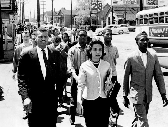 Black leaders march down Jefferson Street at the head of a group of 3000 demonstrators April 19, 1960, and heading toward City Hall on the day of the Z. Alexander Looby bombing. In the first row, are the Rev. C.T. Vivian, left, Diane Nash of Fisk, and Bernard Lafayette of American Baptist Seminary. In the second row are Kenneth Frazier and Curtis Murphy of Tennessee A&I, and Rodney Powell of Meharry. Using his handkerchief in the third row is the Rev. James Lawson, one of the advisors to the students.