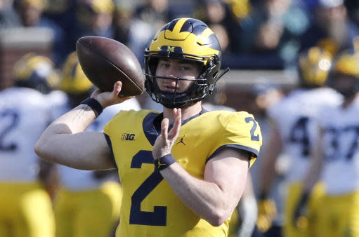FILE- In this April 13, 2019, file photo, Michigan quarterback Shea Patterson throws during Michigan's annual spring NCAA college football game in Ann Arbor, Mich. Patterson returns for a second season after transferring from Mississippi. The dual-threat standout will play behind four returning starters in a new-look offense featuring a trio of talented receivers. (AP Photo/Carlos Osorio)