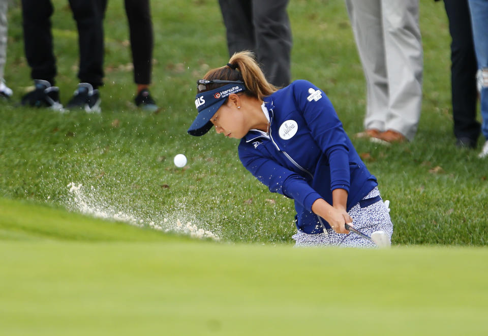 CORRECTS NAME TO JENNY SHIN INSTEAD OF CHELLA CHOI - Jenny Shin, of South Korea, hits out of a trap at the first hole during the third round of the Cognizant Founders Cup golf tournament, Saturday, Oct. 9, 2021, in West Caldwell, N.J. (AP Photo/Noah K. Murray)