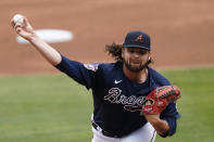 Atlanta Braves starting pitcher Bryse Wilson (46) works in the first inning of a spring training baseball game against the Boston Red Sox Saturday, March 20, 2021, in North Port, Fla. (AP Photo/John Bazemore)