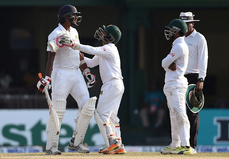 Sri Lanka batsman Suranga Lakmal (left) exchanges words with Bangladesh fielder Sabbir Rahman (far right) during the fourth day of the second Test in Colombo, on March 18, 2017