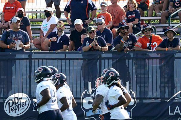 PHOTO: Chicago Bears fans watch players during NFL football practice in Lake Forest, Ill., July 29, 2021. (Nam Huh/AP)