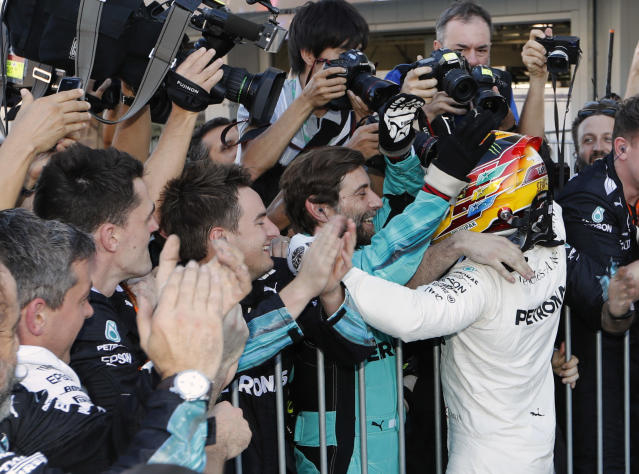 <p>Mercedes driver Lewis Hamilton of Britain is congratulated by his team after winning the Japanese Formula One Grand Prix at Suzuka, Japan, Sunday, Oct. 8, 2017. (AP Photo/Eugene Hoshiko)</p>