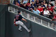 Boston Red Sox right fielder Hunter Renfroe runs against the wall after catching a line dive from Atlanta Braves' Guillermo Heredia during the fifth inning of a baseball game Wednesday, June 16, 2021, in Atlanta. (AP Photo/John Bazemore)