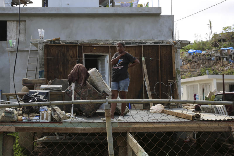 A woman stands in the middle of what used to be her home in Canóvanas, Puerto Rico, on Oct. 14, 2017. (Carolina Moreno/HuffPost)