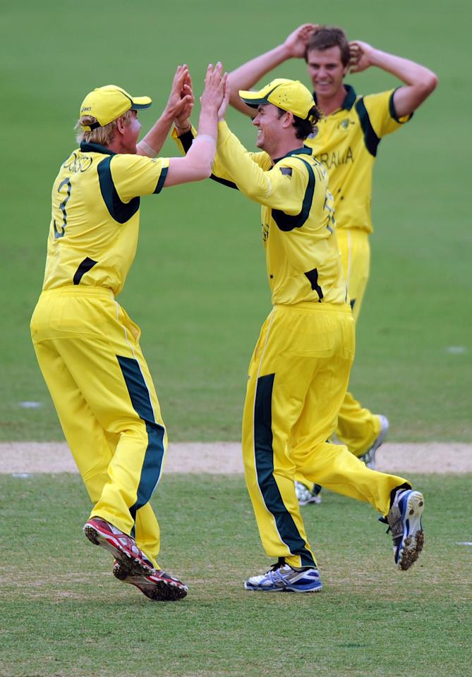 TOWNSVILLE, AUSTRALIA - AUGUST 21:  Australian captain William Bosisto congratulates Ashton Turner (R), who ran out Murray Coetzee of South Africa during the ICC U19 Cricket World Cup 2012 Semi Final match between Australia and South Africa at Tony Ireland Stadium on August 21, 2012 in Townsville, Australia.  (Photo by Malcolm Fairclough-ICC/Getty Images)