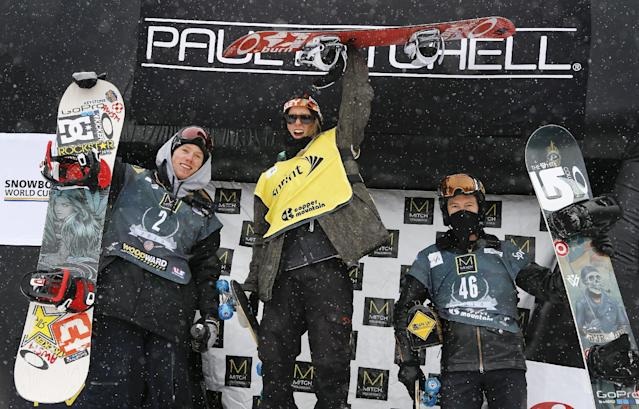 From left, Norway's Torstein Horgmo and Staale Sandbech, stand on the podium with Shaun White during the World Cup U.S. Grand Prix slopestyle snowboarding finals, Sunday, Dec. 22, 2013, in Frisco, Colo. Sandbech finished first followed by Horgmo and White. (AP Photo/Julie Jacobson)