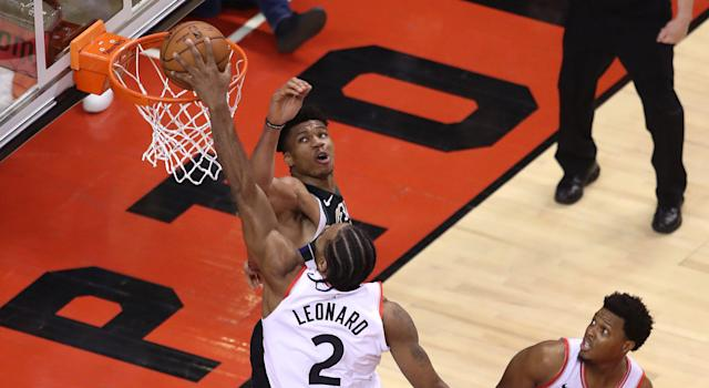 Toronto's Kawhi Leonard provided the highlight of the Raptors' series-clinching win over the Milwaukee Bucks with this dunk on Giannis Antetokounmpo. (Photo by Claus Andersen/Getty Images)