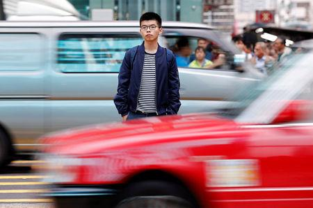 """FILE PHOTO: Student leader Wong poses for a photo ahead of an appeal verdict on charges related to the 2014 pro-democracy protests, also known as """"Occupy Central"""" in Hong Kong"""