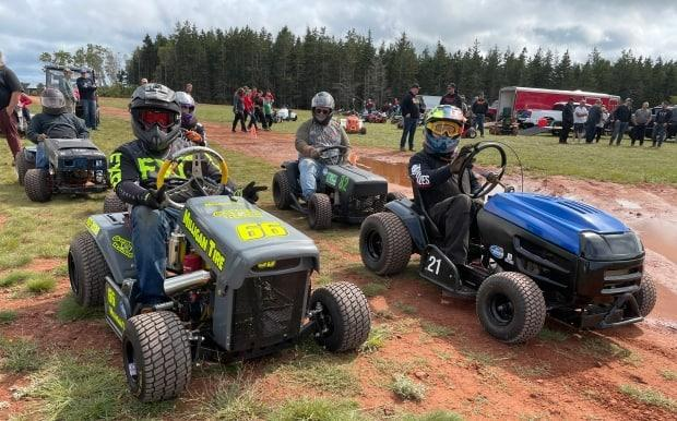 Lawn tractor racers on P.E.I. prepare to hit the track in St. Peters Bay. (Tony Davis/CBC - image credit)