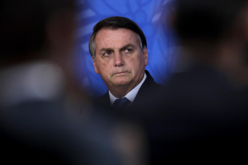 Brazil's President Jair Bolsonaro attends a ceremony to announce a package of relief measures for the aviation industry, one of the most affected by the COVID-19 pandemic, at the Planalto Presidential Palace, in Brasilia, Brazil, Wednesday, Oct. 7, 2020. (AP Photo/Eraldo Peres)