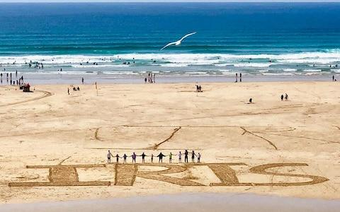 """A beach tribute to Iris, who was described by her mother as """"spectacular"""" - Credit: PA"""