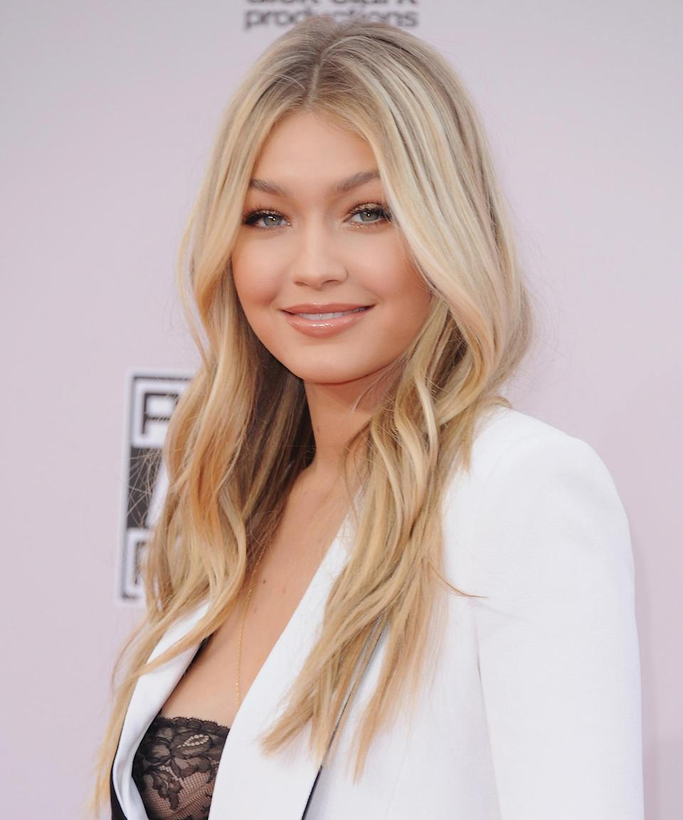 """<h3>2014</h3> <br><br>By 2014, Gigi was on the precipice of achieving official star status. That year she not only landed her first swimsuit edition of <em>Sports Illustrated</em>, but also attended the American Music Awards debuting new icy-blonde highlights.<span class=""""copyright"""">Photo: Jon Kopaloff/FilmMagic.</span><br><br>"""