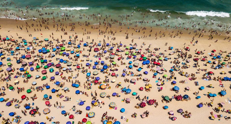 An aerial view of people at Ipanema Beach in Rio de Janeiro, Brazil, on the weekend. Source: Getty Images