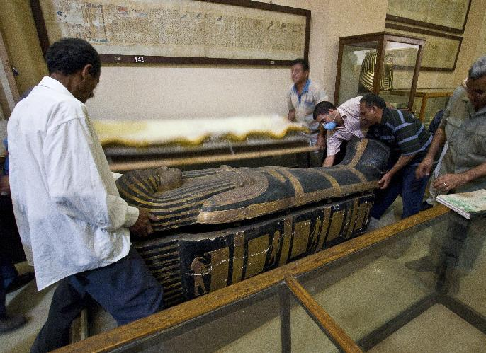 In this undated photo released Sunday March 10, 2013, by a group of cardiologists lead by Saint Luke's Mid America Heart Institute in Kansas City, USA, showing the sarcophagus of the mummy Hatiay (New Kingdom, 18th Dynasty, 1550 to 1295 BCE) as it is closed after the mummy underwent a CT scanning, in Cairo, Egypt. This scanning is part of a major survey to investigate some 137 mummies which has revealed that people probably had clogged arteries and heart disease some 4,000 years ago. CT scans of 137 mummies showed evidence of atherosclerosis, or hardened arteries, in one third of those examined, including those from ancient people believed to have healthy lifestyles. (AP Photo/Dr. Michael Miyamoto)