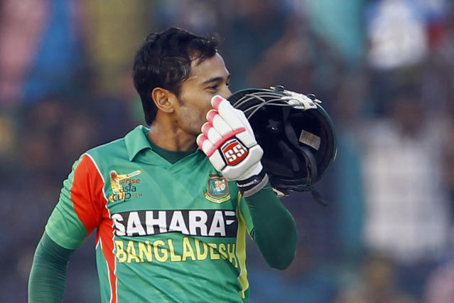 Bangladesh's Mushfiqur Rahim kisses his helmet after scoring a century during the Asia Cup one-day international cricket tournament against India in Fatullah, near Dhaka, Bangladesh, Wednesday, Feb. 26, 2014. (AP Photo/A.M. Ahad)