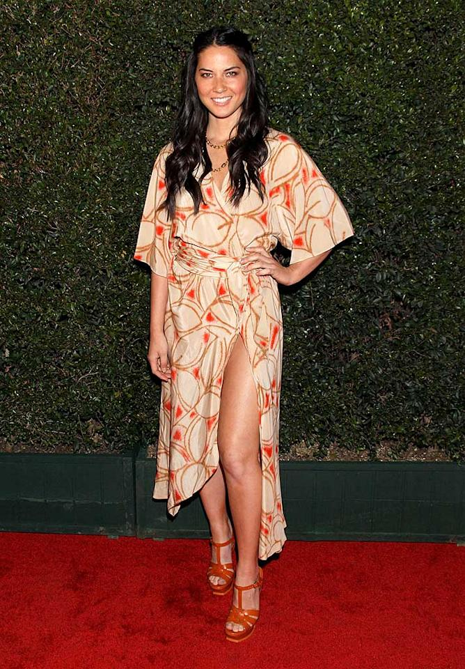 """Olivia Munn popped a pose in print wrap dress at the fancy bash, which raised a total of $601,000 for relief efforts in Haiti. The funds will be administered by the CMMB (Catholic Medical Mission Board) and the William J. Clinton Foundation. Todd Williamson/<a href=""""http://www.wireimage.com"""" target=""""new"""">WireImage.com</a> - March 18, 2010"""