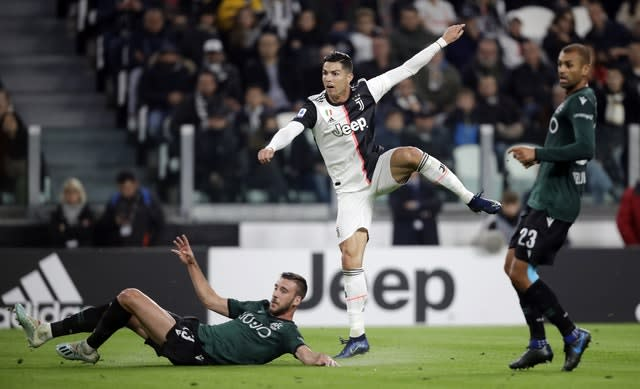 Cristiano Ronaldo (centre) was on target as Juventus extended their unbeaten start and stayed top of Serie A after a 2-1 home win against Bologna (Luca Bruno/AP)