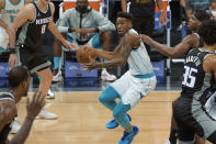 Charlotte Hornets guard Malik Monk (1) works the ball past Sacramento Kings defenders during the first quarter of an NBA basketball game in Sacramento, Calif., Sunday, Feb. 28, 2021. (AP Photo/Randall Benton)