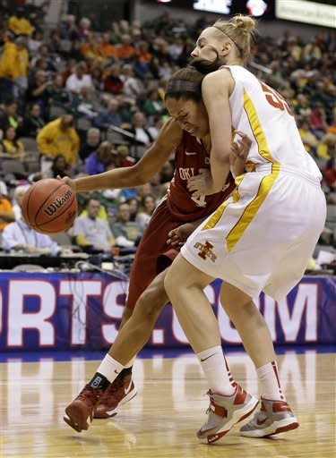 Oklahoma's Nicole Griffin, left, drives against Iowa State's Anna Prins (55) looking for a shot opportunity in the first half of an NCAA college basketball game in the Big 12 Conference women's tournament Sunday, March 10, 2013, in Dallas. (AP Photo/Tony Gutierrez)