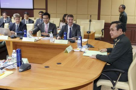 Thailand's newly appointed Prime Minister Prayuth attends a meeting with representatives from the TEBA at the Royal Thai Army headquarters in Bangkok