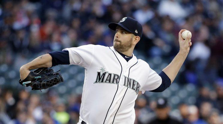 Seattle Mariners starting pitcher James Paxton throws against the Texas Rangers in the third inning of a baseball game Saturday, April 15, 2017, in Seattle. (AP Photo/Elaine Thompson)