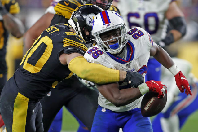 Pittsburgh Steelers outside linebacker T.J. Watt (90) strips the ball from Buffalo Bills running back Devin Singletary (26) and the Steelers recovered during the second half of an NFL football game in Pittsburgh, Sunday, Dec. 15, 2019. (AP Photo/Keith Srakocic)
