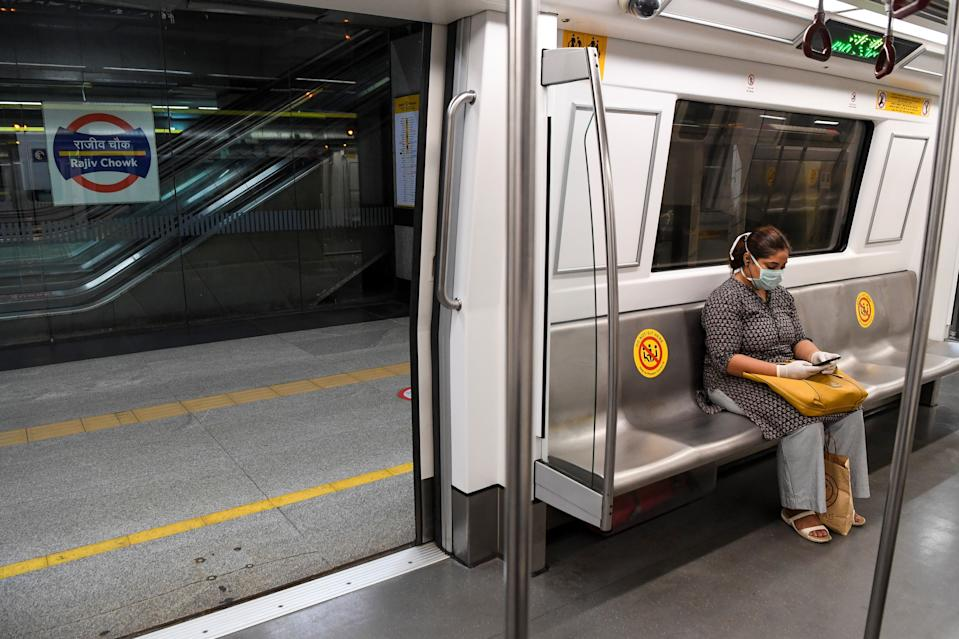 A commuter sits in a carriage of a Yellow Line train after Delhi Metro Rail Corporation (DMRC) resumed services in New Delhi on September 7, 2020.(Photo by PRAKASH SINGH/AFP via Getty Images)