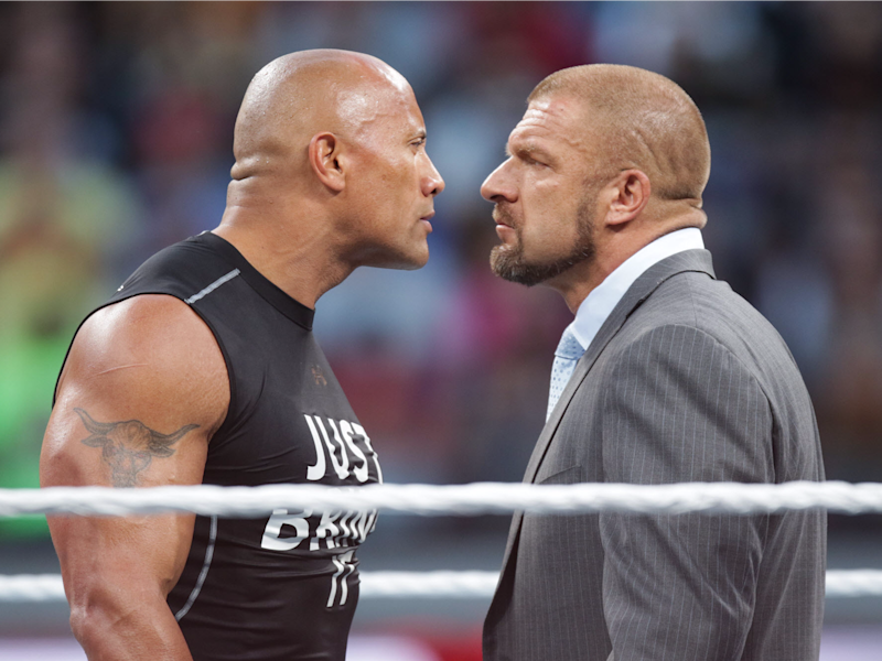 Dwayne the Rock Johnson stares off against WWE superstar Triple H