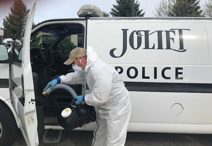 About 100 Joliet squad cars are being sanitized to ward off the new coronavirus thanks to donations from two small Joliet businesses. Image via John Ferak/Patch