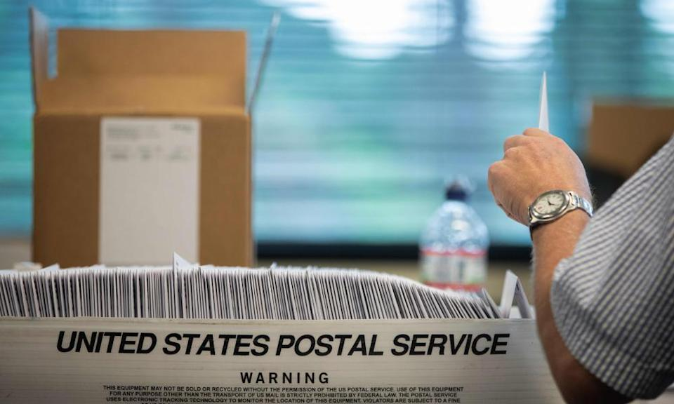 The pandemic is expected to lead to a record number of mail-in ballots but the postal service lack experience and states could struggle to process them.